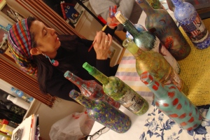 Ana Peguero Paints her Bottles